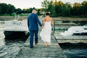 Cople walking down the dock on their wedding day